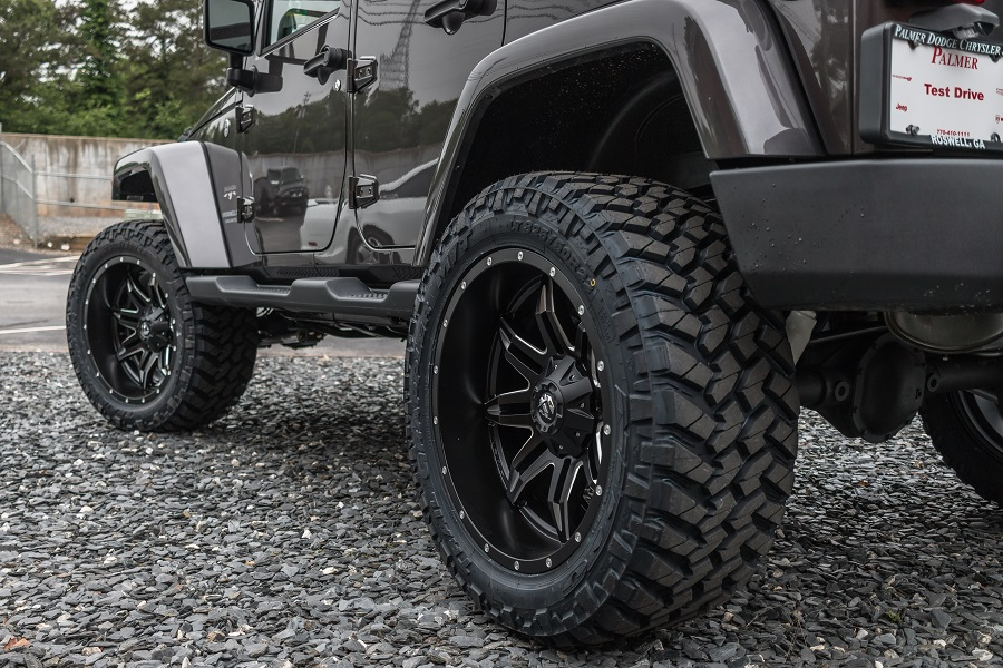 Custom Lifted Jeep Sahara - 20×10 Black Aluminum Wheels